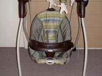 We have a Graco Swing for sale including swing, strap