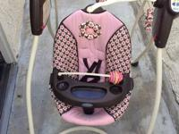 Selling a Graco baby girl swing for $55. In excellent
