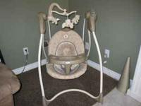Fantastic Graco Baby Swing with a Winnie the Pooh