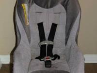 This is a grey Graco Car seat with adjustable shoulder