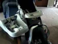 Black and gray carseat,stroller, and seat base that