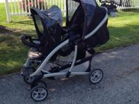 Used double stroller from Graco. Everything works and