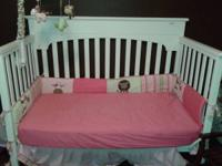 Crib is in excellent condition - converts from crib to
