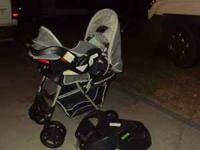 THIS IS A BLUE STROLLER/CARRIER COMBO WITH CARSEAT