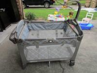 Graco Pack And Play. There are no rips pulls or stains