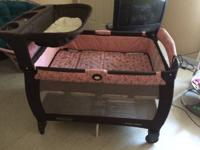 Graco Pack-n-Play with altering table and bassinet.