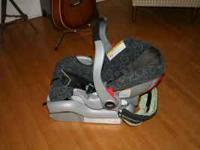 Graco SnugRide 32. $75.00 CASH ONLY. Dark charcoal with