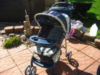 Blue graco stroller in great condition. Has cup holder
