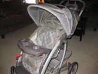 Light brown/light blue Graco stroller in great