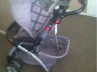 Graco Stroller. Black plastics, black/purple/grey