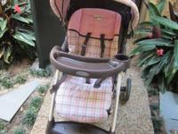 This pink and brown plaid set is gently used. This set