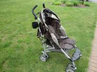 Brown Stroller - Rarely Used. Call  or email to come