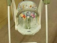 Graco Swing. Features 6 speeds, mobile, music, and
