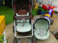 Graco Travel System, Green & Brown plaid type print.