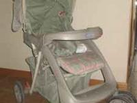 Graco stroller with infant carrier seat and base.