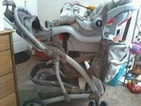 Text Kerri ..or  Graco Quattro travel system(car seat,
