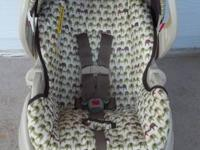 This tan and green Graco infant seat with base is $45