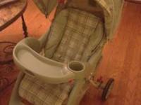 Green and cream plaid infant car seat, stroller and