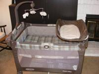Graco Pack 'n Play, like brand-new. Features smiling