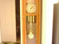 grand father clock in brand new condition made by ridge