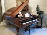 Selling vintage grand piano. About 7 feet long. Built