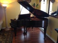 This beautiful 5'3 Red Mahogany baby grand piano is