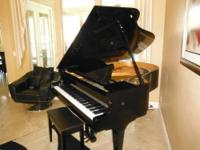 This Vogel grand piano is made by SCHIMMEL. PIANO was