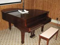 "This 5'7"" grand piano was manufactured in 1982. The"
