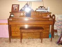 For sale is a good upright piano and bench. The brand
