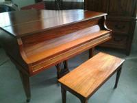 "Size: The piano measures 4'8-1/2""long. The serial # on"