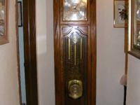 This is a Howard Miller Grandfather clock. Bronson