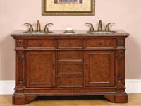 This traditional double sink vanity features a poplar