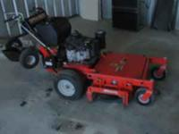 "Gravely 32"" ride behind mower with sulky Jungle Wheels."