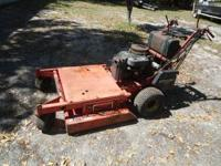 13hp Kawasaki, belt drive. This is a older unit but