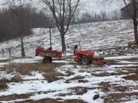 Older 2 wheel tractor . Has rotary plow, snow blade, 30