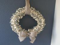 This wreath is made from white and grey burlap