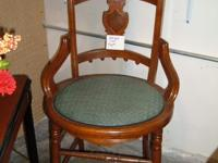 Beautiful dark wood chair with blueish green cushion -