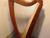This Triplett Catalina Harp is 56 inches tall, weighing