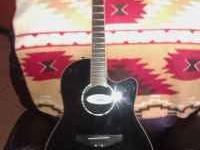 Great condition ovation, celebrity guitar. Comes with