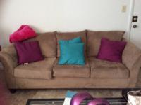 Tan/Mocha Serta love seat only lightly used for about a