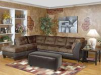 A sheer beauty. This remarkable two-tone sectional