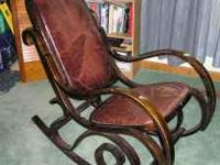 A great rocking chair that is made of real wood and