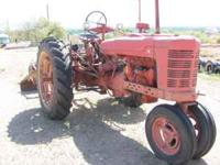 Great old FARMALL Have a few implements that go with