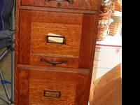 This is a great antique mission filing cabinet. Such a