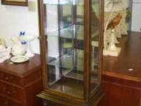 CHECK IT OUT WE HAVE AN OLDER CURIO (68x18x12D) WITH