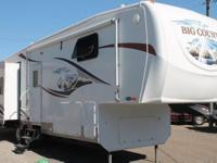 This 2008 Big Country 3075 RL features three slideouts