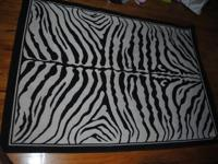 Zebra print Center rug. Can also be used to accentuate