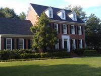 This all brick home in the heart of Evans is loaded