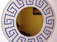 Unique, handmade, cast-stone mirrors with many designs