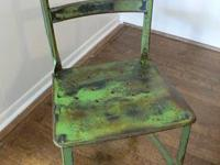 Vintage Toledo-style metal chair with perforated seat.